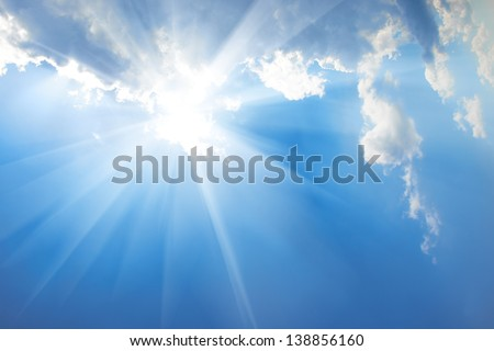 Beautiful blue sky with sunbeams and clouds. Sun rays. #138856160