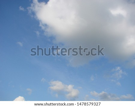 Beautiful blue sky with sunbeams and clouds. Sun rays. #1478579327