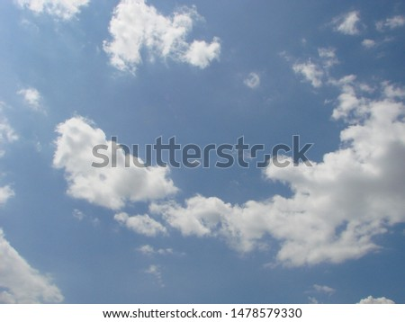 Beautiful blue sky with sunbeams and clouds. Sun rays. #1478579330