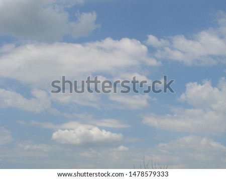 Beautiful blue sky with sunbeams and clouds. Sun rays. #1478579333