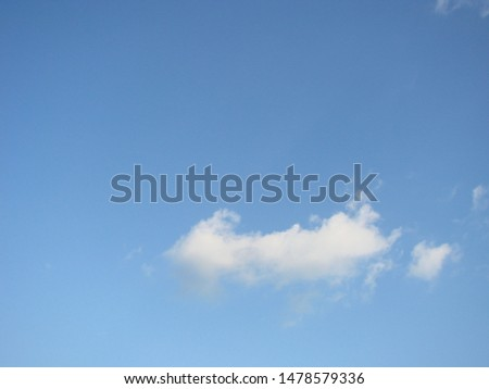 Beautiful blue sky with sunbeams and clouds. Sun rays. #1478579336