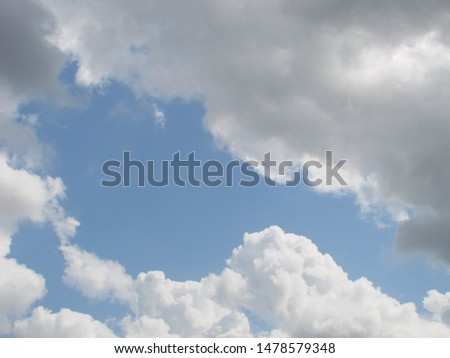 Beautiful blue sky with sunbeams and clouds. Sun rays. #1478579348