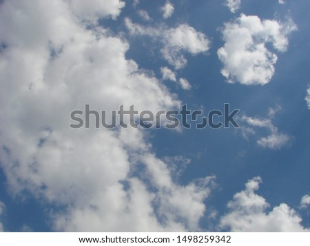 Beautiful blue sky with sunbeams and clouds. Sun rays. #1498259342