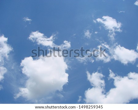 Beautiful blue sky with sunbeams and clouds. Sun rays. #1498259345