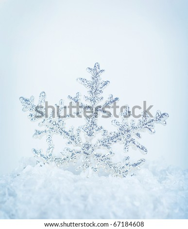 Beautiful blue snowflake winter holiday background