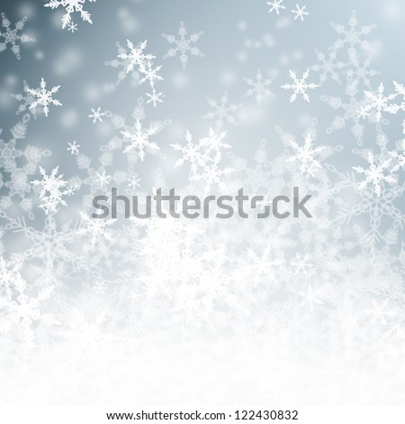 Beautiful blue sparkling snowy winter background with copy space.