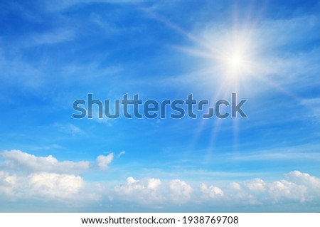 Beautiful, blue summer sky with fluffy clouds and bright sun as a background Foto stock ©