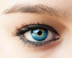 Beautiful blue woman eye close up