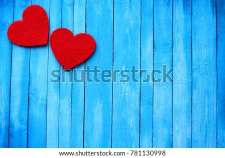 Beautiful blue wooden background with red hearts. Best card for Valentine`s day. I love you! Happy Valentina`s Day!