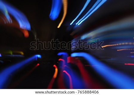 Beautiful blur and bokeh images. christmas light night,abstract circular bokeh background.bokeh lights and car lights illuminate the streets. #765888406