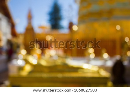 Beautiful blurred picture and yellow or golden color bokey or bokeh from the temple background with blue sky for concept design and decorative workings
