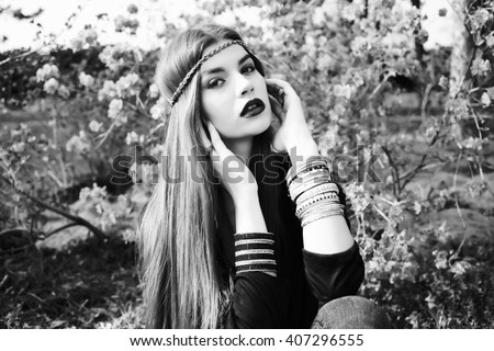 Beautiful bohemian girl in spring garden. Black and white photo of beautiful woman