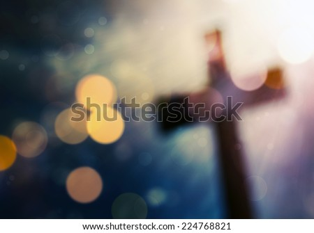 Beautiful bokeh with a cross in the background #224768821