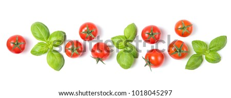 Beautiful border made of fresh cherry tomatoes with basil leaves, isolated on white background, vegetable pattern, top view #1018045297