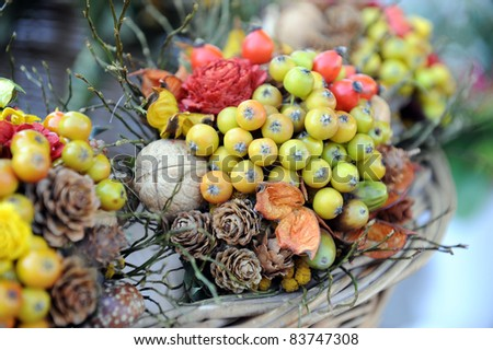 Beautiful bouquet from flowers, fruit and berries
