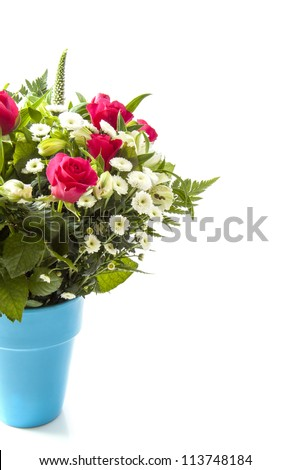 Beautiful bouquet in blue vase on a white background