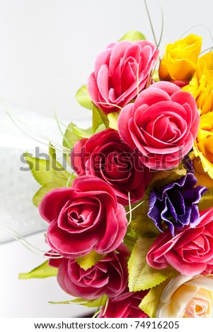 Beautiful bouquet of artificial flowers. Copyspace on the left.