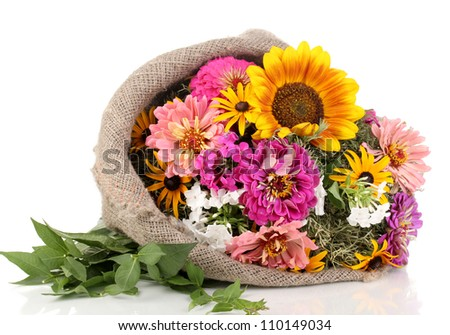 Beautiful bouquet of bright flowers in sacking isolated on white