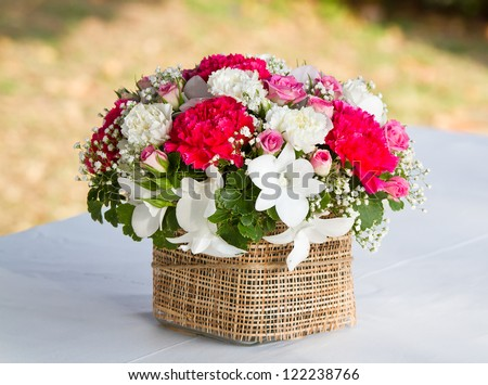 beautiful bouquet of bright wildflowers in basket