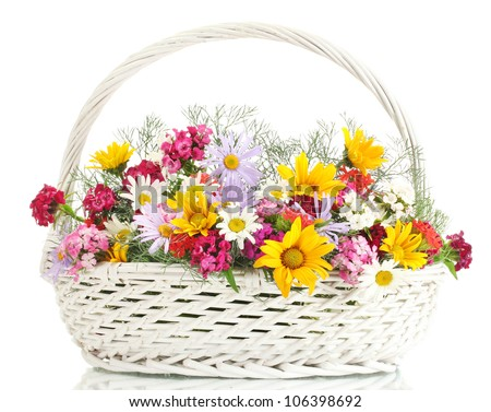 beautiful bouquet of bright  wildflowers in basket, isolated on white