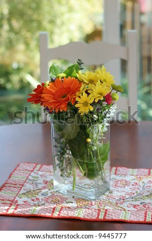 beautiful bouquet of colorful flowers in vase on kithcen table