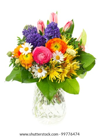 beautiful bouquet of colorful spring flowers in a glass vase. tulip, ranunculus, hyacinth, daisy, gerber
