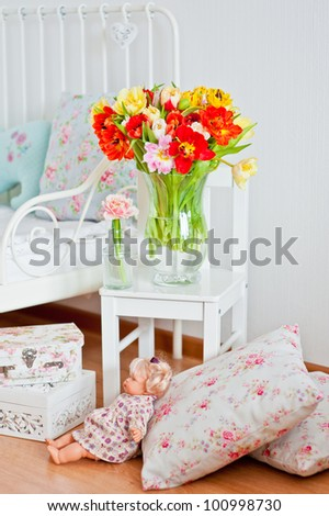 Beautiful bouquet of colorful tulips in interior of child room