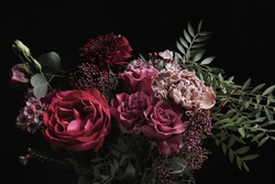 Beautiful bouquet of different flowers on black background. Floral card design with dark vintage effect
