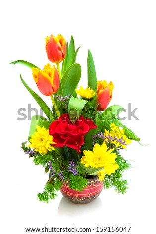 beautiful bouquet of fresh flowers in a wooden pot isolated on a white background. vertical photo