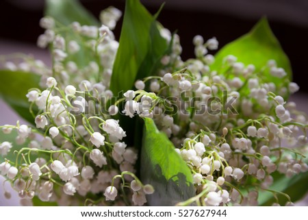 Beautiful bouquet of lily of  valley is on  table