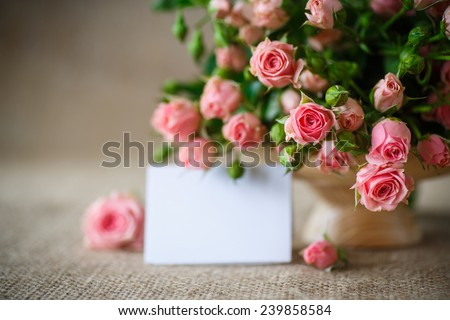 beautiful bouquet of pink roses on an old table of burlap