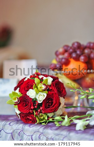 beautiful bouquet of rose flowers, on table .wedding bouquet  from red roses.elegant wedding bouquet on table at restaurant