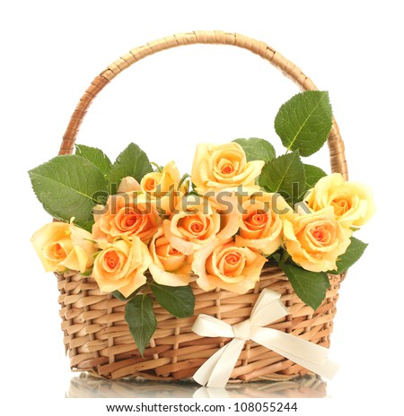 beautiful bouquet of roses in basket isolated on white