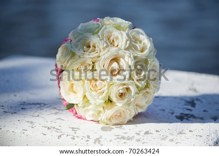 beautiful bouquet of the bride executed from light beige roses