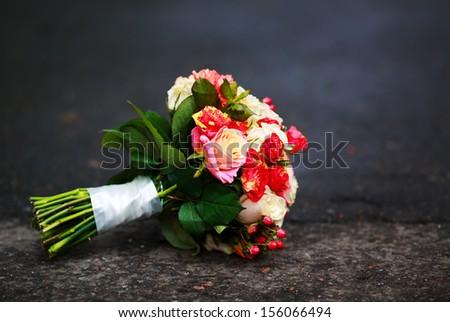 beautiful Bouquet of various flowers on an asphalt