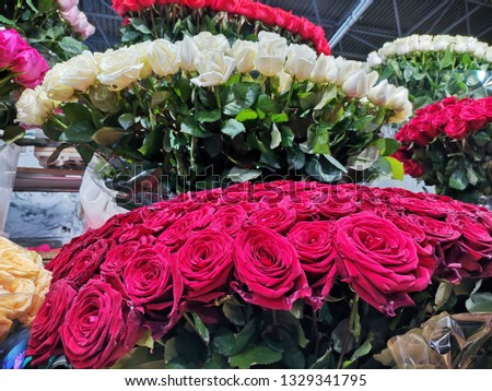 Beautiful bouquets, bouquets of white and red roses on the counter of the flower market, gifts to women on March 8 #1329341795