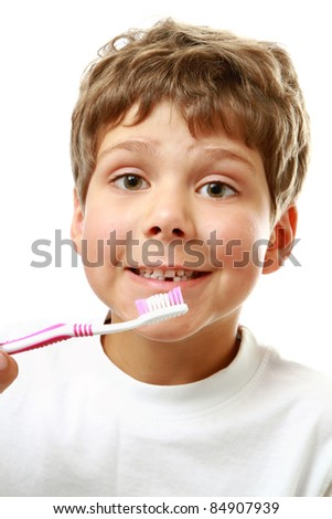 Beautiful boy brushing teeth