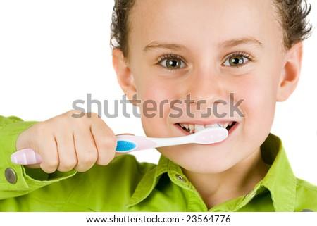 Beautiful boy brushing teeth, isolated on white