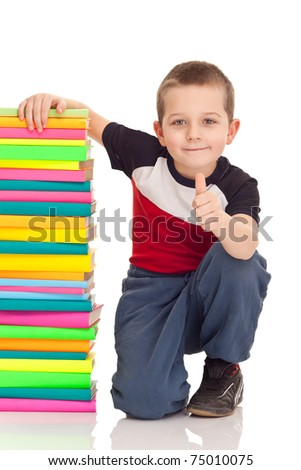 beautiful boy with school books, showing OK sign,  isolated on white
