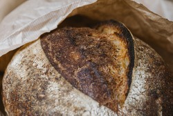 Beautiful bread close-up. Bread from shop in craft package. Grain surface texture.