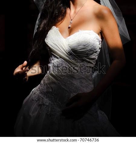 beautiful breasts in a wedding dress closeup