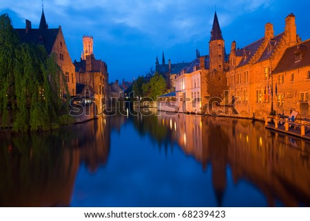 Beautiful brick architecture is reflected in the canal in front of RozenhoedKaai in the old city of Bruges, Belgium