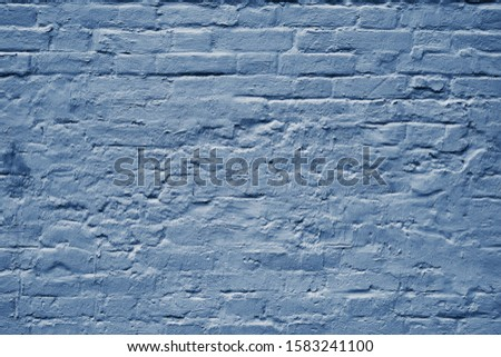Beautiful brick wall grunge decorative classic blue background. Classic blue colour monochrome texture banner with space for text. Grunge classic blue texture. Monochrome classic blue background.