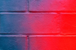 Beautiful bricks colorful street art graffiti background. Abstract gradient spray drawing fashion colors on the brick walls of the city. Urban  orange , pink , purple , crimson, blue texture