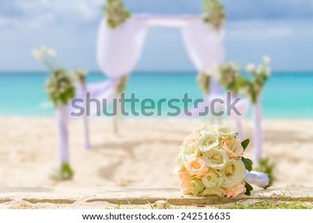 beautiful bridal bouquet on wedding arch background, outdoor beach wedding
