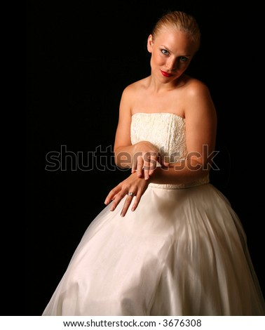 Beautiful Bride Against Dramatic Black Background