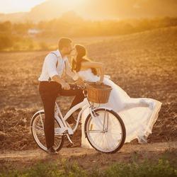 Beautiful bride and groom wedding portrait with white bike