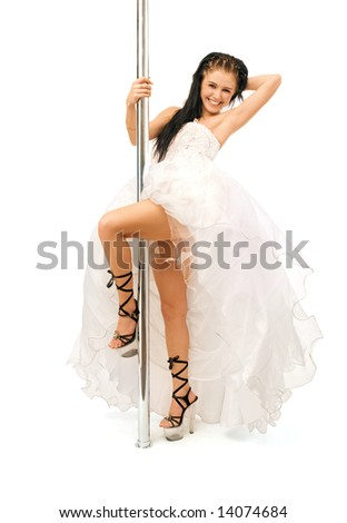 beautiful bride dancing striptease isolated on white - stock photo