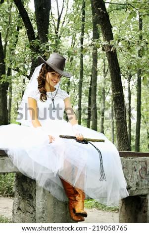 beautiful bride in a cowboy hat ...