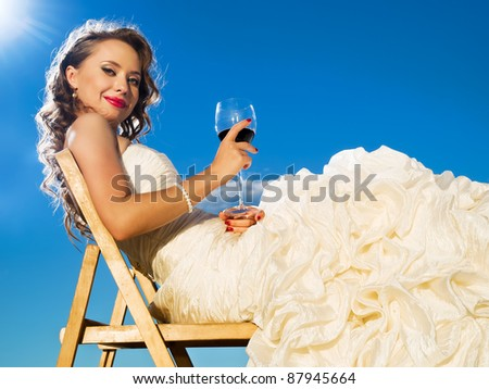 beautiful bride in front of the blue sky